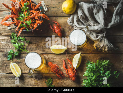Wheat beer and boiled crayfish with lemon, parsley - Stock Photo