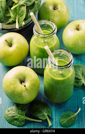 Green smoothie with spinach in glass - Stock Photo