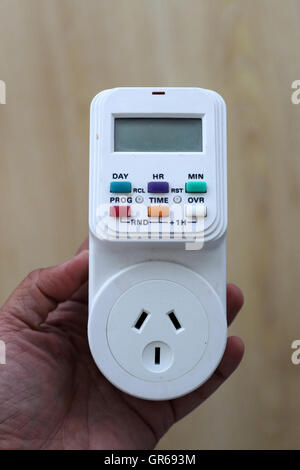 Electronic digital Timer Socket Plug in - Stock Photo