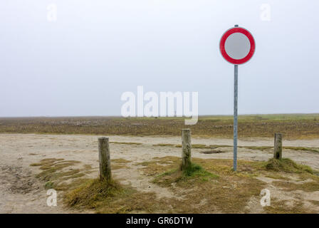 Traffic Sign On The Beach - Stock Photo