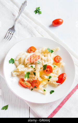 Italian pasta with roasted cherry tomatoes, cheese and parsley - Stock Photo