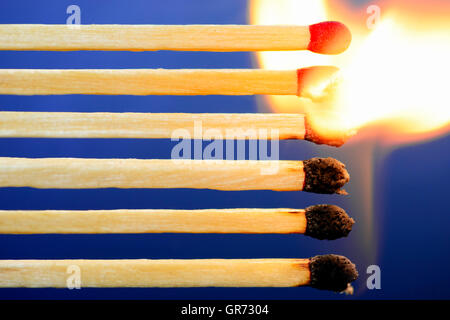 Burning Matches, Domino Effect - Stock Photo