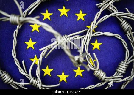 Flag Of The Eu And Barbed Wire, Flow Of Refugees - Stock Photo