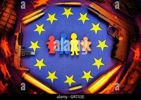 Eu Flag, Weapons And Miniature Family Figures, Wave Of Refugees - Stock Photo