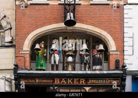 Chiming clock with figures in Baker's Jewelery and Watchmaker shop, Gloucester, Gloucestershire, UK - Stock Photo