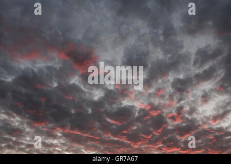 Evening Sky With Dark And Red Clouds In Lower Saxony, Germany - Stock Photo