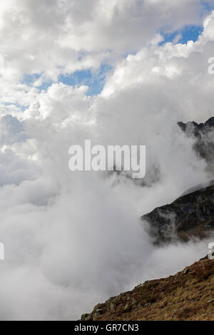 Impressive Clouds And Bustle In The Urner Alps - Stock Photo