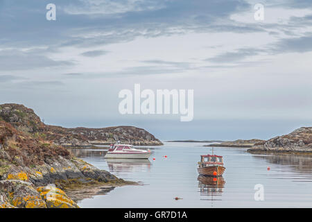 Fishing Boat Anchored On The Sheltered Harbor Entrance - Stock Photo