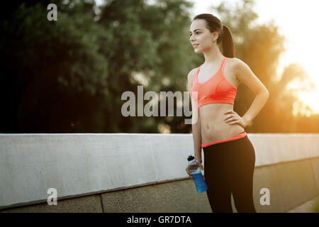 Sporty jogger going for a run in urban city area - Stock Photo