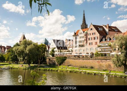 ULM, GERMANY - AUGUST 13: People walking along the Danube river in Ulm, Germany on August 13, 2016. - Stock Photo