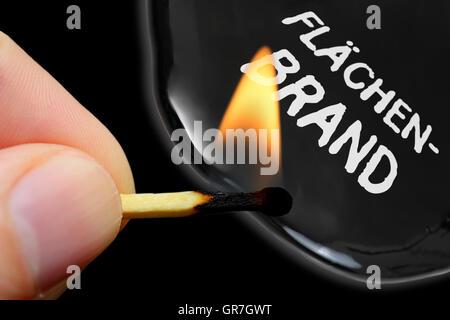 Finger Holding Burning Match, Terror Threats - Stock Photo