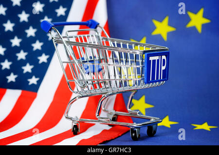 Shopping Cart In Front Of Flags Of The Usa And The Eu, Ttip Trade Agreement - Stock Photo