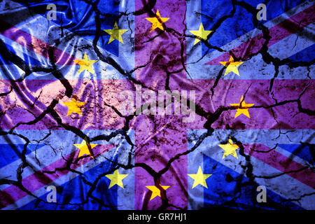 Flag Of Great Britain And Eu On Cracked Ground - Stock Photo