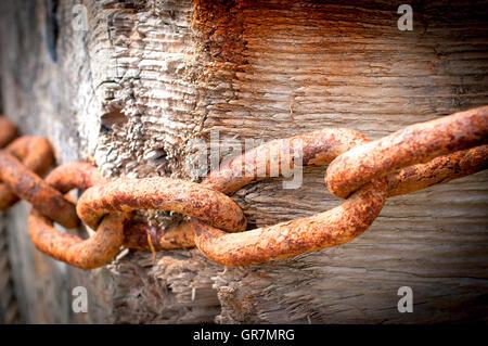 Old mooring blocks with rusting chains, Faversham Creek, Kent. - Stock Photo