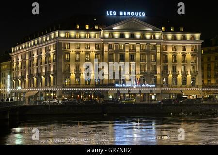 Four Seasons Hotel Des Bergues At Night, Geneva, Switzerland - Stock Photo