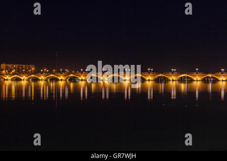 Night view of The Pont de pierre (Stone Bridge) (1819-1822), Bordeaux, France - Stock Photo