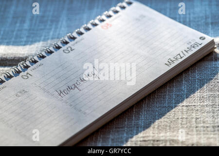 An Opened Desk Calendar With The Entry - Stock Photo