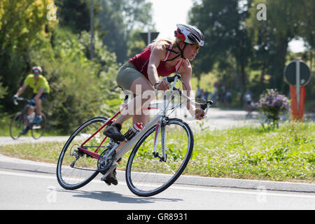 Young Woman Fights At A Triathlon For A Good Ranking - Stock Photo