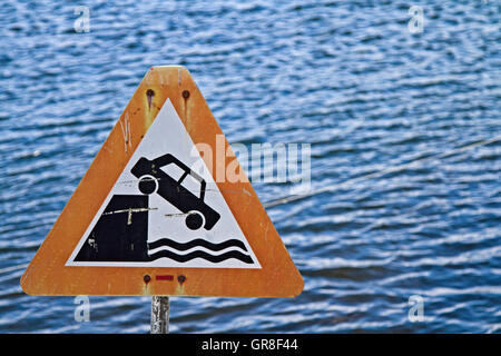 Sign Warning Of The Abrupt End Of The Road - Stock Photo