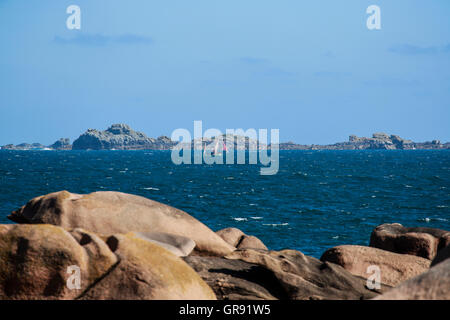 A Boat In A Bay Near Ploumanach, Brittany - Stock Photo
