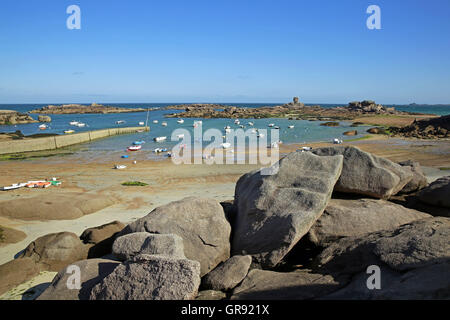 Boats At Low Tide In A Bay Near Ploumanach, Brittany, France - Stock Photo