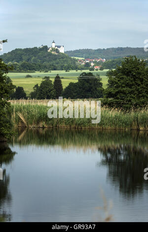Looking Out Over A Pond To Ranis In The Background, Thuringia, Germany, Europe - Stock Photo