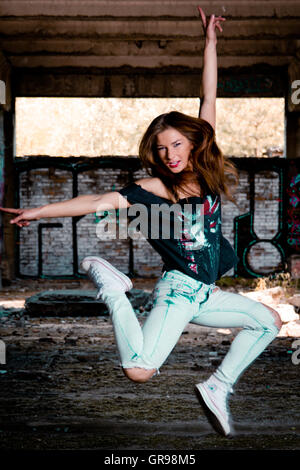 Portrait Of Beautiful Young Woman Jumping In Excitement - Stock Photo