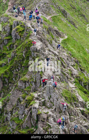 People walking on Striding Edge, Helvellyn, Lake District, Cumbria, England, United Kingdom - Stock Photo