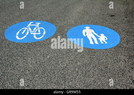 Painted Traffic Sign Cycle Path And Footpath On Street - Stock Photo