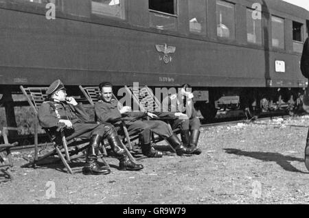 German Wehrmacht Soldiers In Front Of A Train On The 2Nd War - Stock Photo