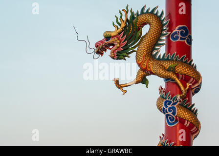 Low Angle View Of Chinese Dragon Sculpture On Pole Against Clear Sky - Stock Photo