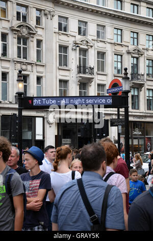 Oxford Circus underground station, London UK. Sign promoting the new all night service on the Victoria Line, August - Stock Photo