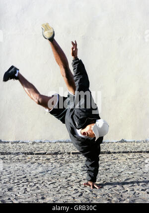 Memebers of the hip hop dance troupe 'Pumps' perform and pose for portraits in the streets of Sao Felipe, Fogo, - Stock Photo