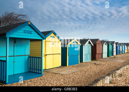 Beach huts on Calshot beach, Hampshire, UK - Stock Photo
