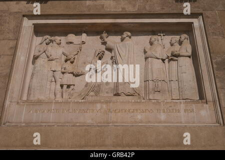 Bas relief representing the crowning of St Stephen (Istvan), first king of Hungary, on the outside wall of St Stephen's - Stock Photo