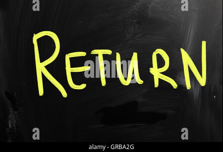 Return handwritten with white chalk on a blackboard - Stock Photo