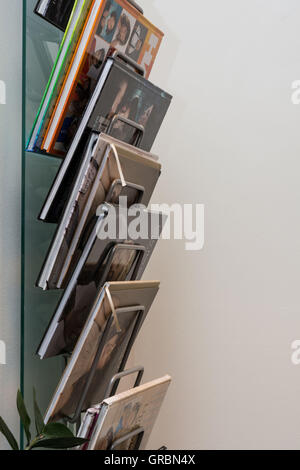 Modern Magazine Rack Offers Clear Selection Of Books - Stock Photo