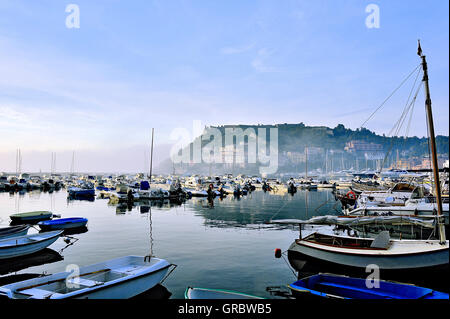 Mist In The Bay Of Porto Ercole In The Morning, Coastal Town Of The Tuscany, Italy - Stock Photo