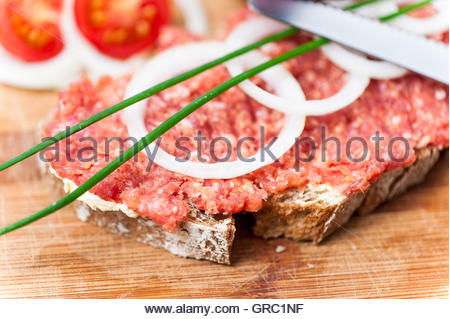 Bread Topped With Ground Pork , Onions And Tomatoes - Stock Photo