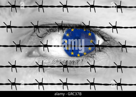 Flag Of Eu In A Woman S Eye Behind Barbed Wire - Stock Photo