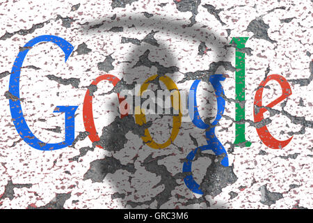 Eroding Google Sign On A Wall With Shadow Of Grim Reaper - Stock Photo