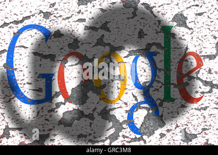 Eroding Google Sign On A Wall With Shadow Of A Paragraph - Stock Photo