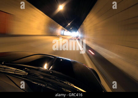 Car Driving Through Katschbergtunnel In Austria - Stock Photo