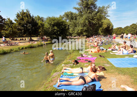 Crowded Lawn During Heat Wave At Englischer Garten In Munich - Stock Photo