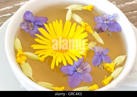 Cough Tea With Coltsfoot, Violet And Cowslip In A White Teacup - Stock Photo