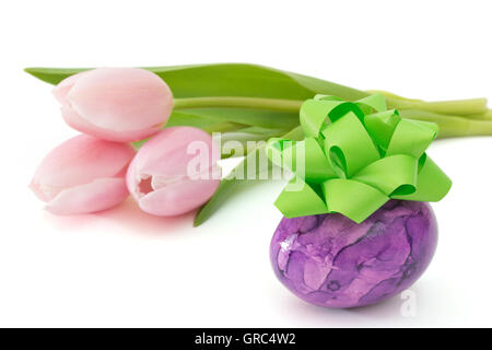 Purple Easter Egg With Bow Near Pink Tulips On White Background - Stock Photo