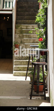 Seating-Accommodation In A Courtyard - Stock Photo