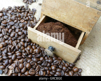 Old Mechanical Coffee Grinder With Coffee Beans And Coffee Powder - Stock Photo