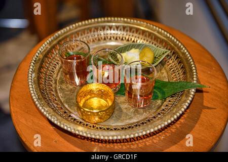 Fancy ya dong Thai white spirits with herbs at a bar in Bangkok, Thailand - Stock Photo