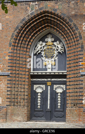 Entrance Door With Figures Of Angels To Nikolai Church In Wismar Mecklenburg-Vorpommern - Stock Photo